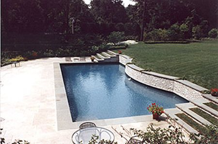 Pools in a sloping yard photo shows the structure under for Pool design sloped yard