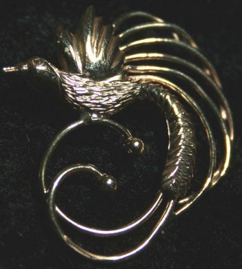 A beautiful crafted gold bird of paradise pendant papuanewguinea a beautiful crafted gold bird of paradise pendant papuanewguinea aloadofball Images