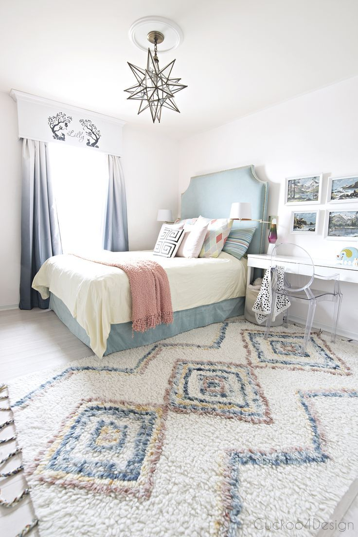 turquoise, yellow and blue girls bedroom with colored Moroccan shag and DIY bed made from Ikea curtains via @jakonya