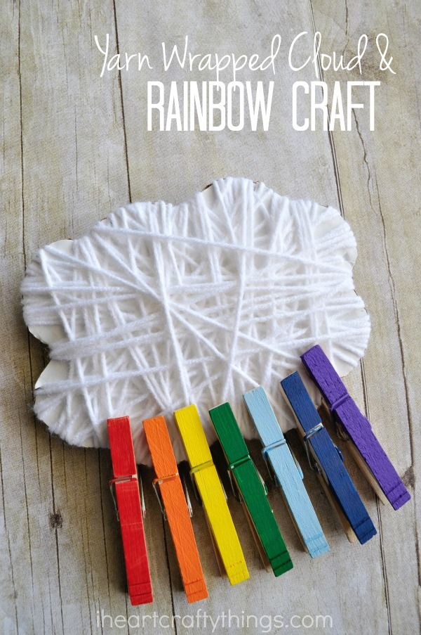 This yarn wrapped cloud and rainbow craft is super simple and it's a great spring activity for working on colors and strengthening fine motor muscles with toddlers and preschoolers.