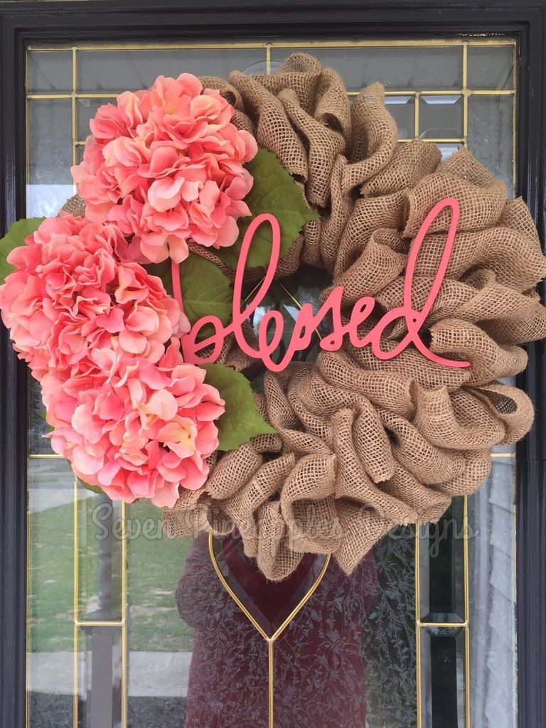 """Photo of Sackcloth wreath with hydrangeas and """"Blessed"""" sign"""