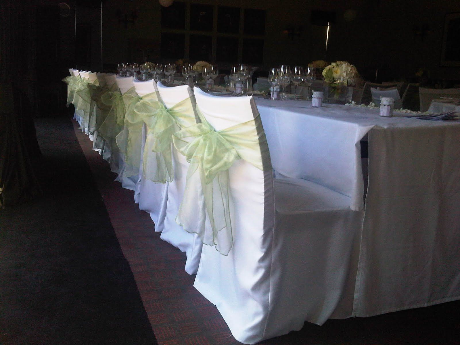 Sage Organza chair sashes over White chair covers our decorator