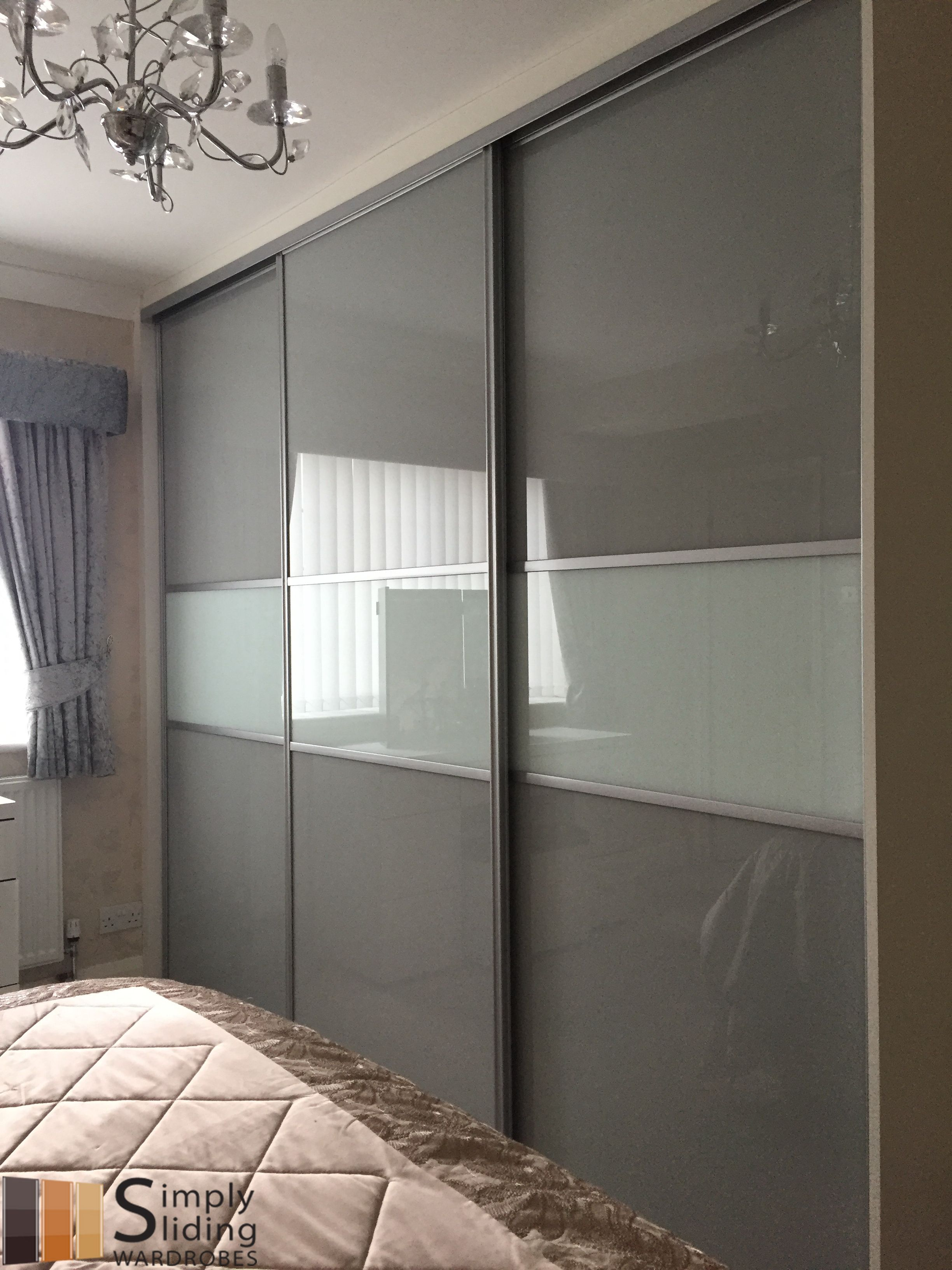 One Of Our Multi Panel Grey Glass Sliding Door Wardrobes Wardrobe Door Designs Sliding Door Wardrobe Designs Wardrobe Design Bedroom