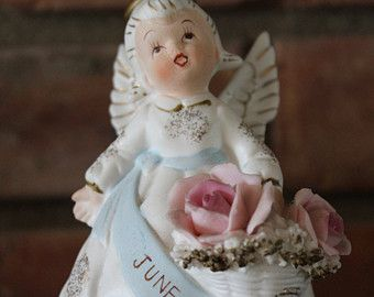 June Birthday Angel Gold Halo Carrying Pink Blue Bouquet