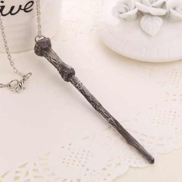 """Harry Potter Magic Wand Necklace Unique silver colored Harry Potter magic wand necklace. 20"""" long chain, 4-1/2"""" long wand. Other wands available. Jewelry Necklaces"""