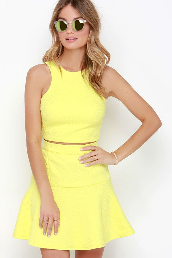 """As Seen On Elizabeth of A Keene Sense of Style blog! The Grow to Glow Yellow Two-Piece Dress will have you radiating sunshine and sweetness! Intricately quilted stretch knit fabric shapes a rounded neckline and sloping, notched arm openings above a cropped, tailored bodice with an exposed gold zipper at back. Matching skirt has a high waistline and a fitted, darted silhouette that meets a flaring, drop-waist ruffle. Small top measures 15.5"""" long. Small bottom measures 18.5"""" long."""