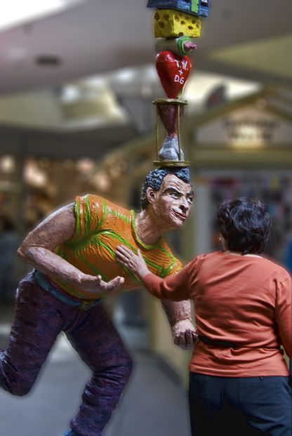 """Balancing Act Too"" (1993) by Tony Natsoulas - life sized painted bronze sculptures inside Downtown Plaza demonstrate competing thoughts on shoppers' minds"