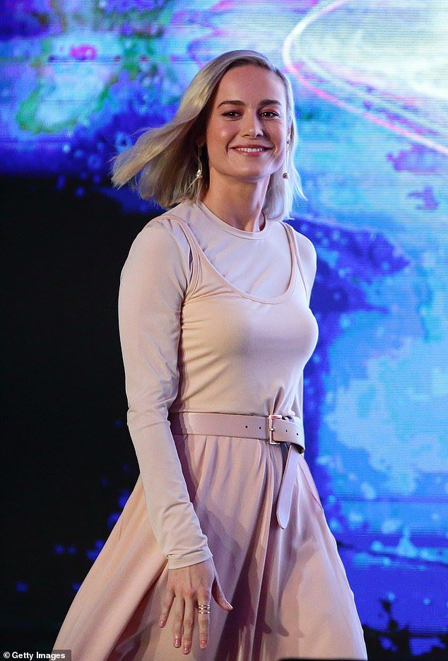 Photo of Brie Larson channels ballerina chic and smiles at fans in Singapore