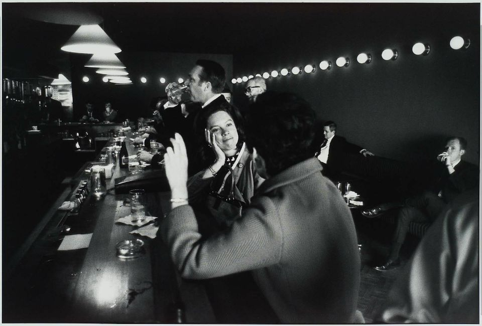 Garry Winogrand, Untitled (Two women at bar) from the Women are Beautiful portfolio, published 1981.