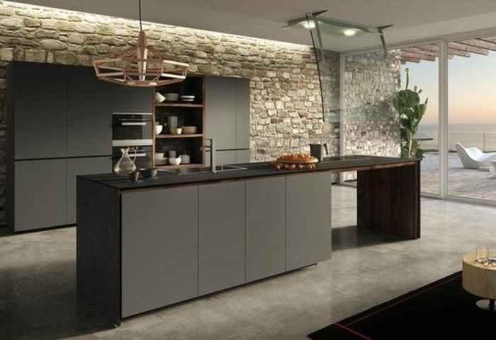 ilot cuisine et meuble cuisine gris anthracite, mur en pierre