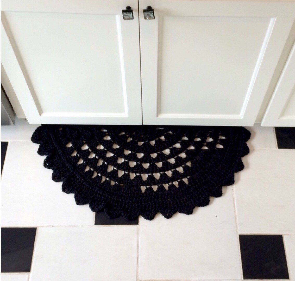 Hand Crocheted Semi Circle Rug- Black Cotton by YourHomeyHome on Etsy https://www.etsy.com/listing/219648466/hand-crocheted-semi-circle-rug-black