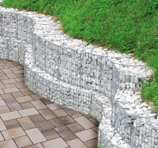 curved gabion wall created by site cutting standard rectangular gabions. Black Bedroom Furniture Sets. Home Design Ideas