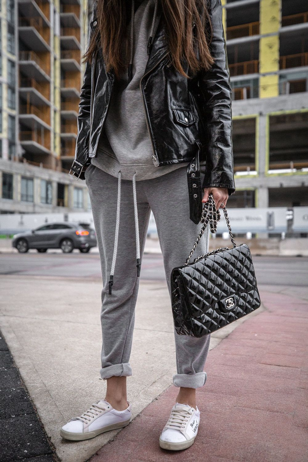 How To Style A Sweatsuit Leather Jacket Outfits Athleisure Outfits Sweatpants Outfit