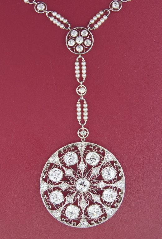 Important Edwardian necklace created in Europe in the 1910's. Nine approx. 0.90-ct each Old European cut diamonds, delicate filigree openwork and seed pearl accents are the highlights of this beautiful piece.
