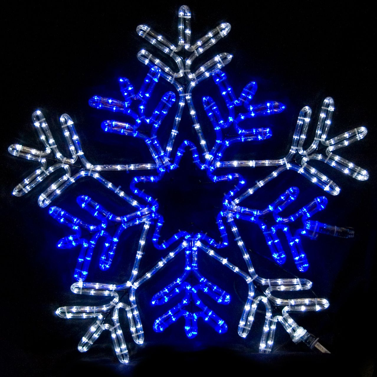 Brightly Lit Christmas Decorations Including This 26 Inch Snowflake With  Blue Center.