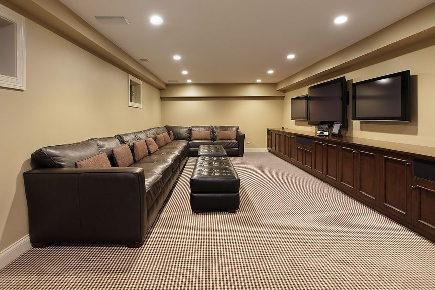 Simple Man Cave With A Huge Sectional Leather Sofa And 3 Wall Mounted Flat Screen Televisions