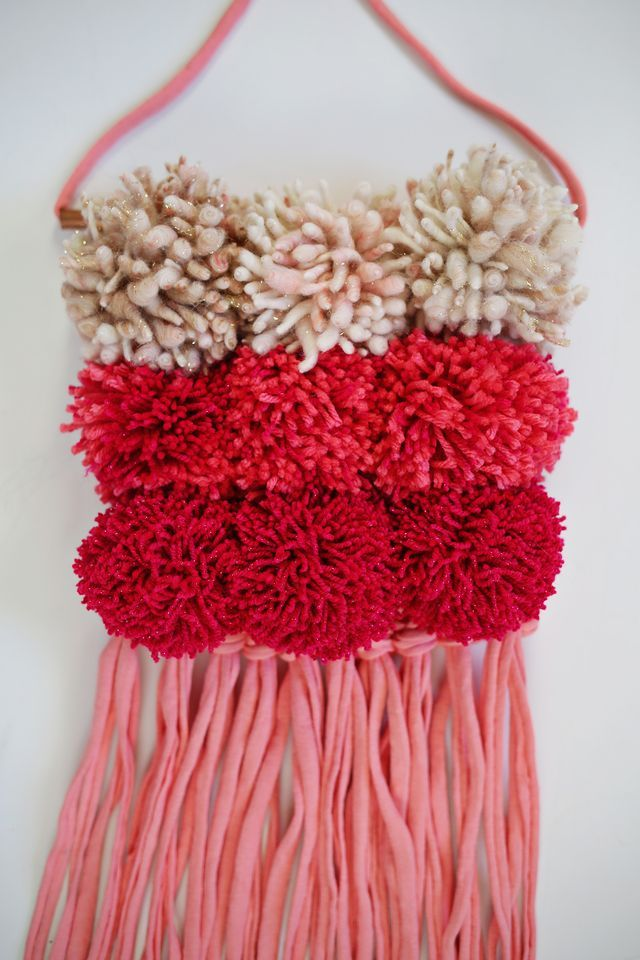 Pom Pom Wall Hanging add pom poms to a plain weave wall hanging for gorgeous color and