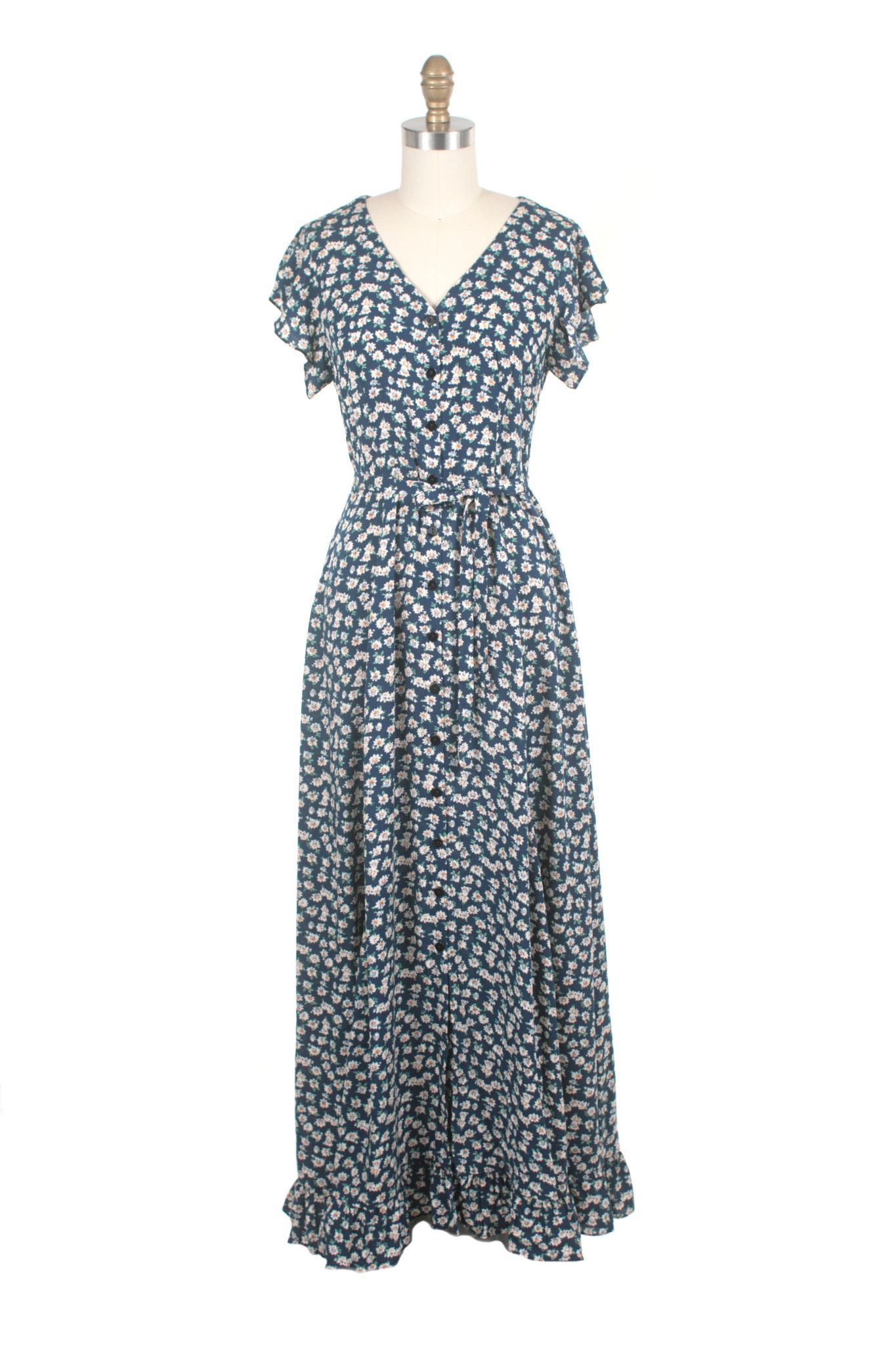 Blue rayon print with white flowers maxi button down dress with blue rayon print with white flowers maxi button down dress with ruffle sleeves and a wide ruffle hem inseam side pockets unlined rayon imported izmirmasajfo