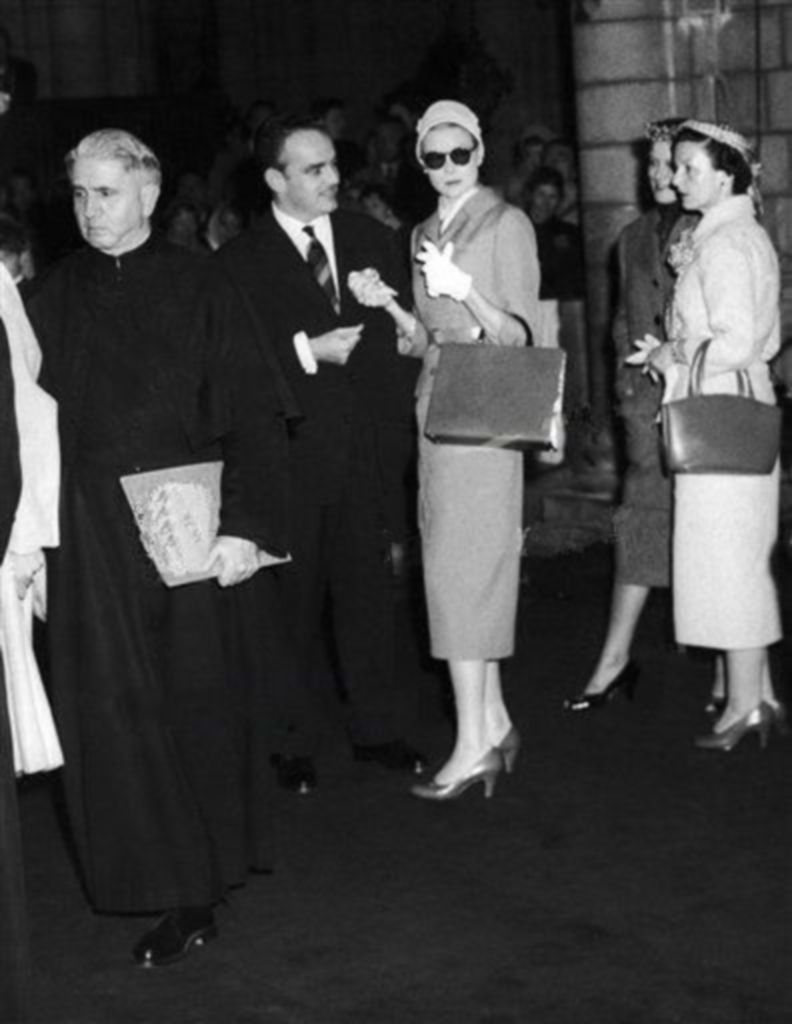 Grace Kelly and Prince Rainier are at Monaco Cathedral for a wedding rehearsal, on April 16, 1956. Grace's mother Mrs. Margaret Kelly,right, with the Prince's sister, Princess Antoinette.