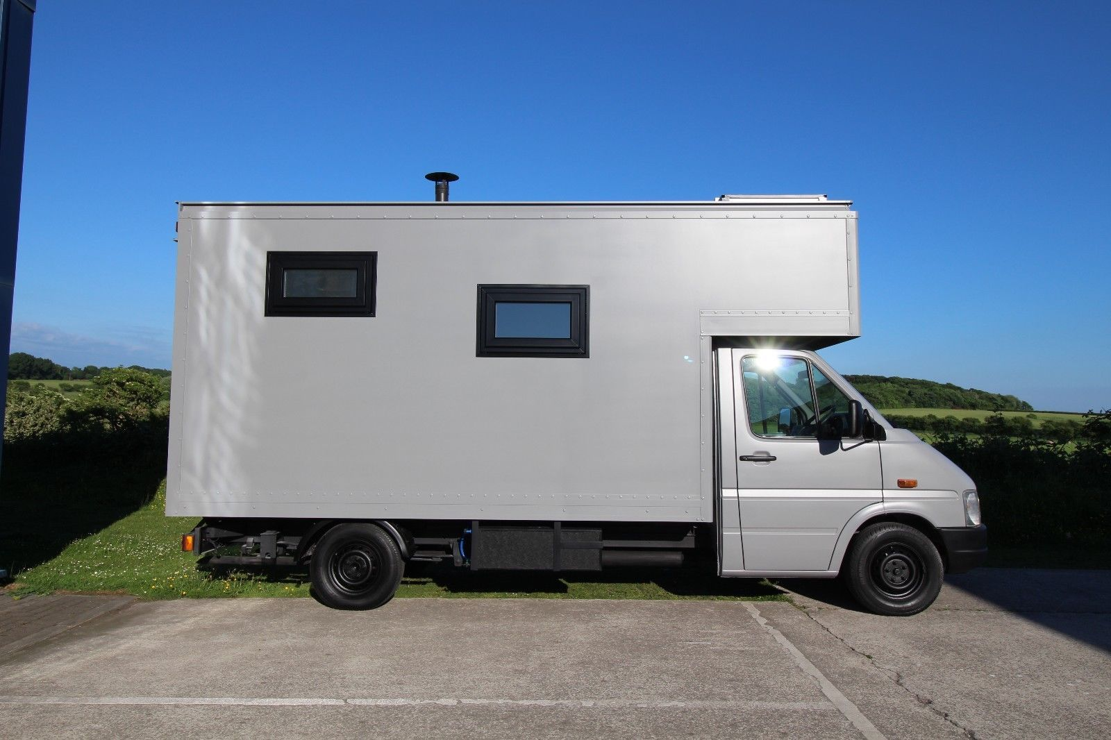 medium resolution of this converted volkswagen lt35 luton box van has a spacious kitchen lounging area and a large wet bath with a shower