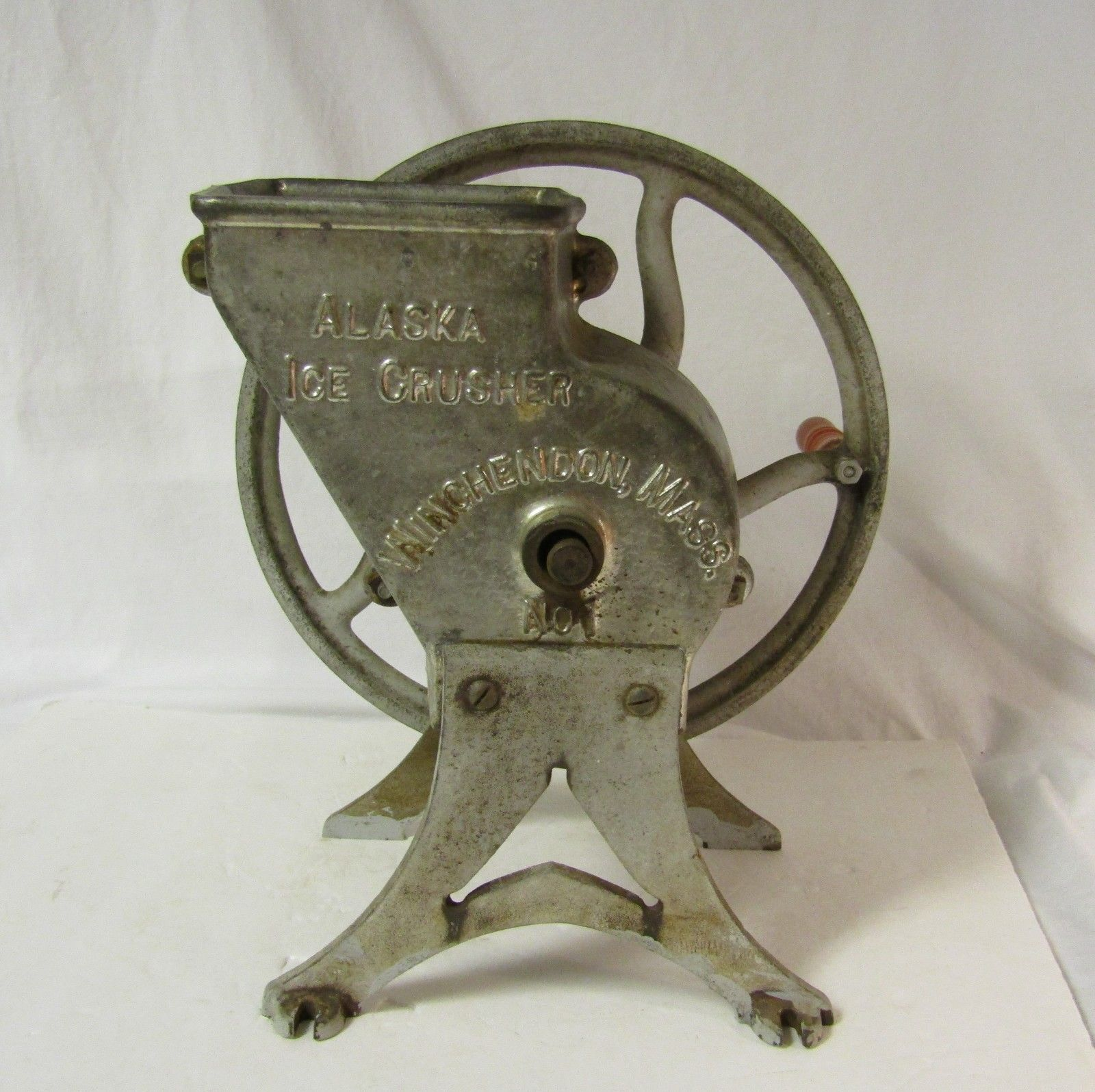 Looks circa early 1900s. The crusher part is cast iron or