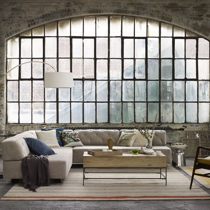 Tufted Sectional Sofa In A Warehouse Style Space