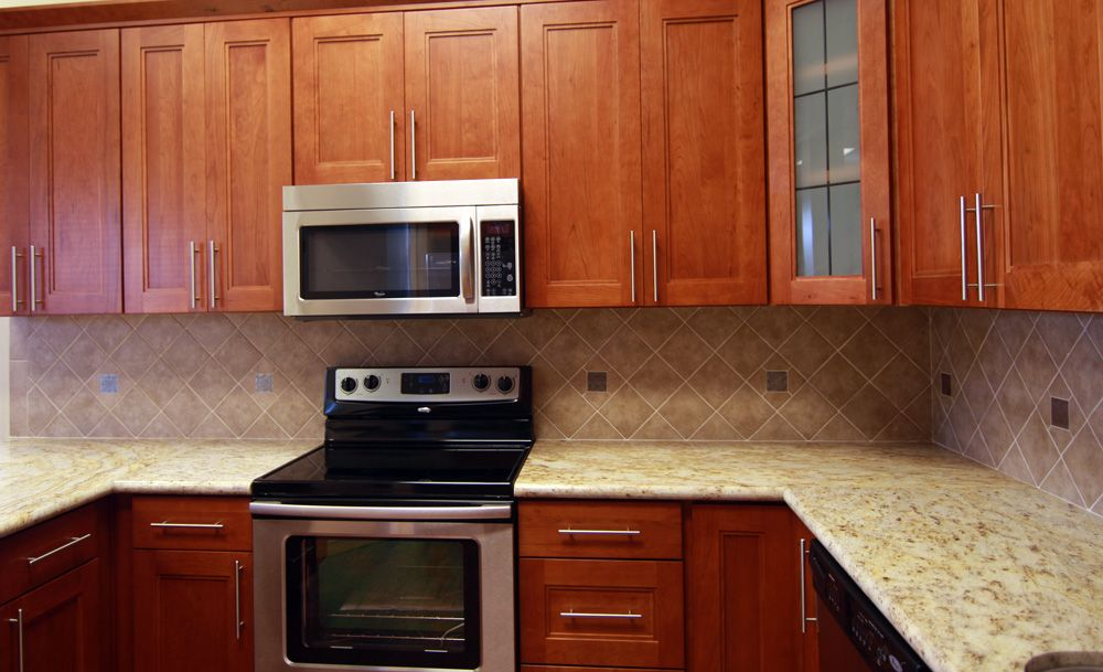 Natural Cherry Cabinets With Granite Shaker On Cabinet And Graniteon