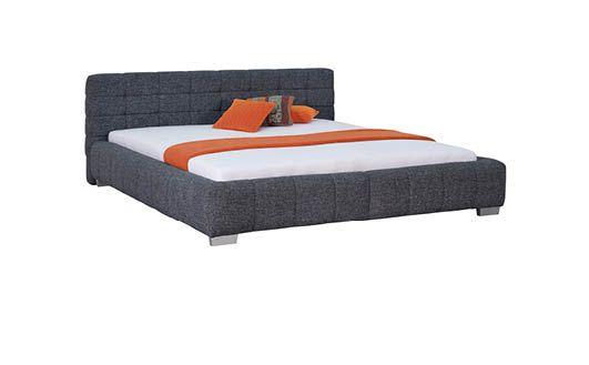 čalúnená posteľ