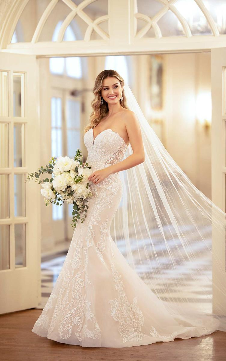 Try On This Stunning Gown At Our Charming Boutique In Downtown