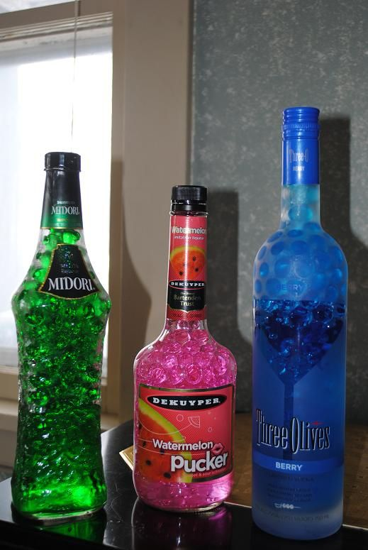 Fill empty alcohol bottles with bright colored water beads for How to color wine bottles