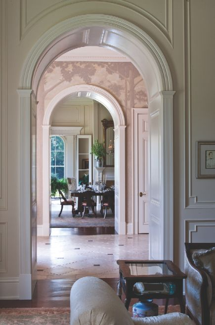 Arched doorways frame the view from the formal living room in Mary ...