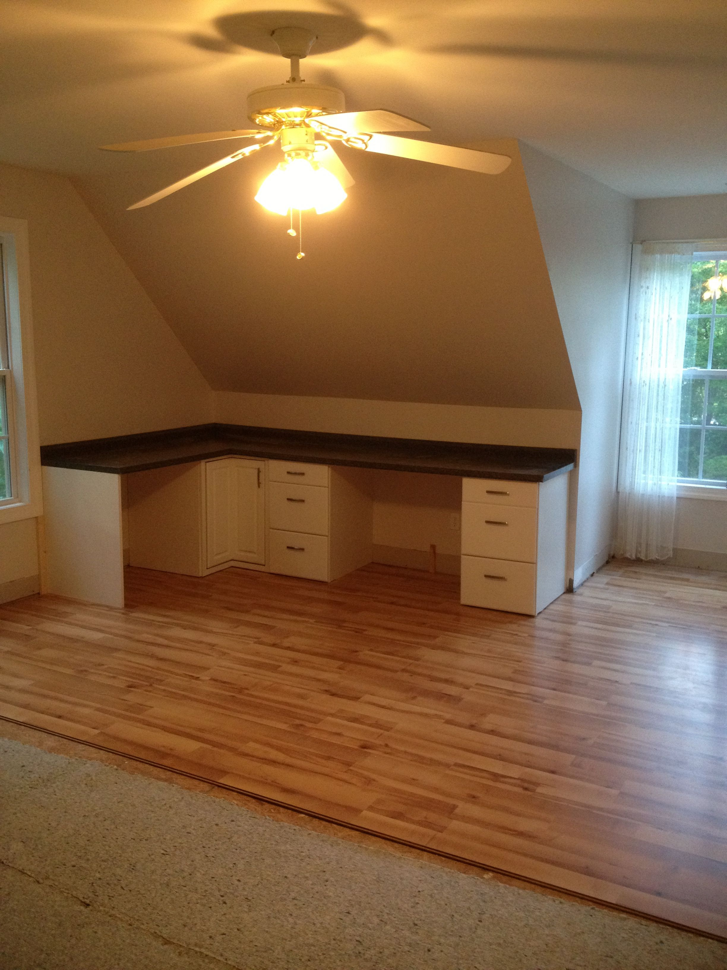 Built in desk and laminate floors Attic renovation