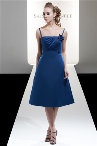 bridesmaid dress, maybe in a light pink, orange, or light yellow.