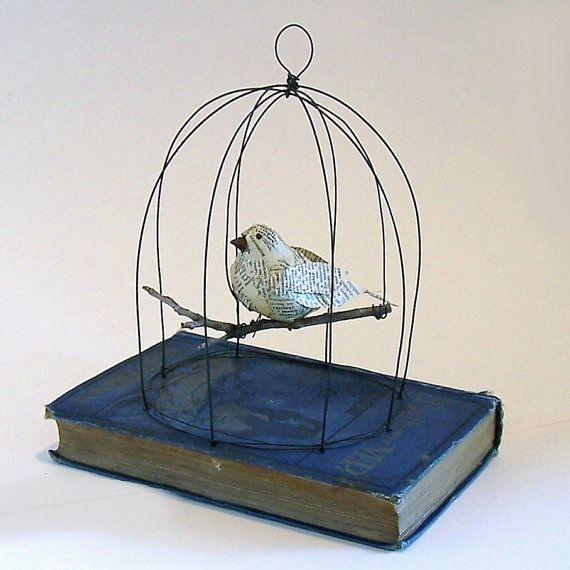 paper mache bird, home made cage--so cute! I could make a bird out of fabric instead!