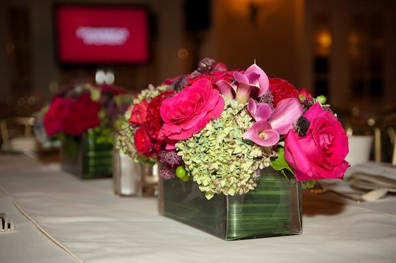 Centerpiece rectangular vase overflowing with a lush