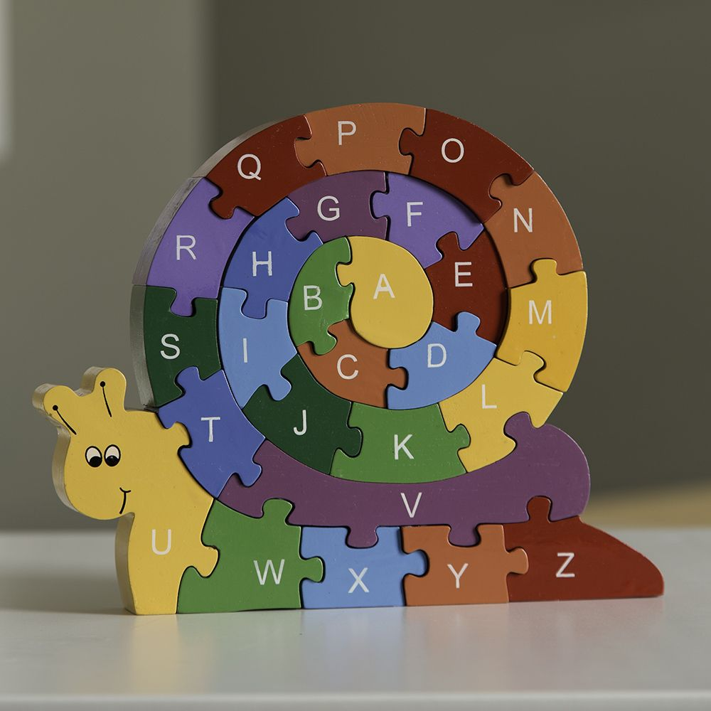 @WorldCrafts {Educational Snail Puzzle ~ Gospel House Handicrafts ~ Sri Lanka} This wooden puzzle in the shape of a snail is perfect for teaching children colors, counting and the alphabet. Each wooden elephant snail puzzle piece is painted a bold primary color and features numbers on one side with a capital letter on the opposite side. #fairtrade