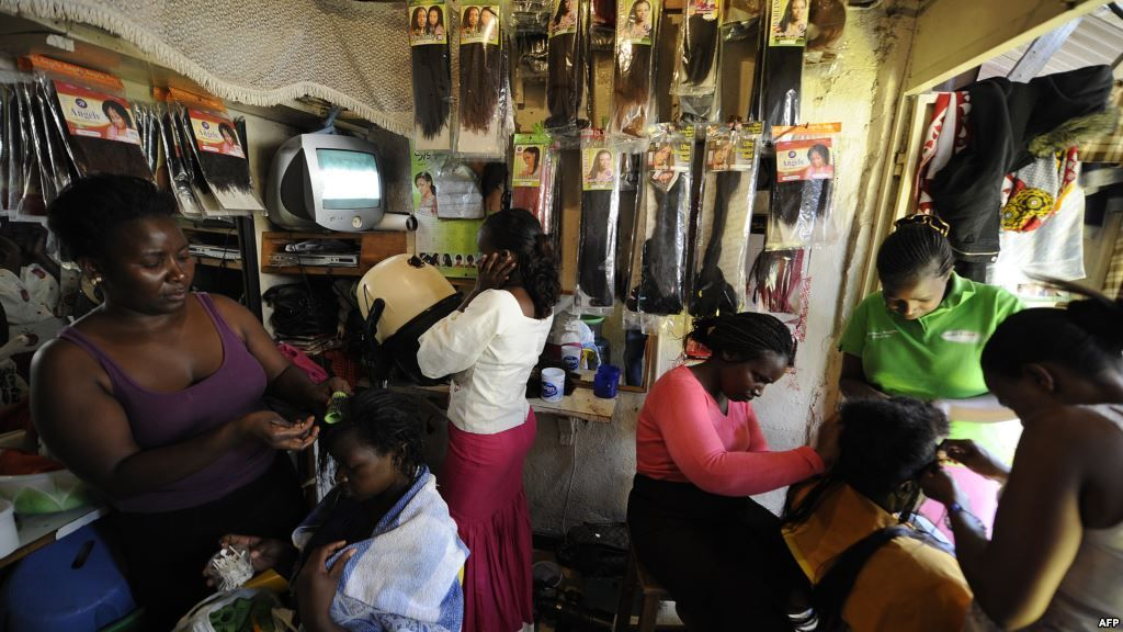 Hairdressers attend to clients at a salon in the capital