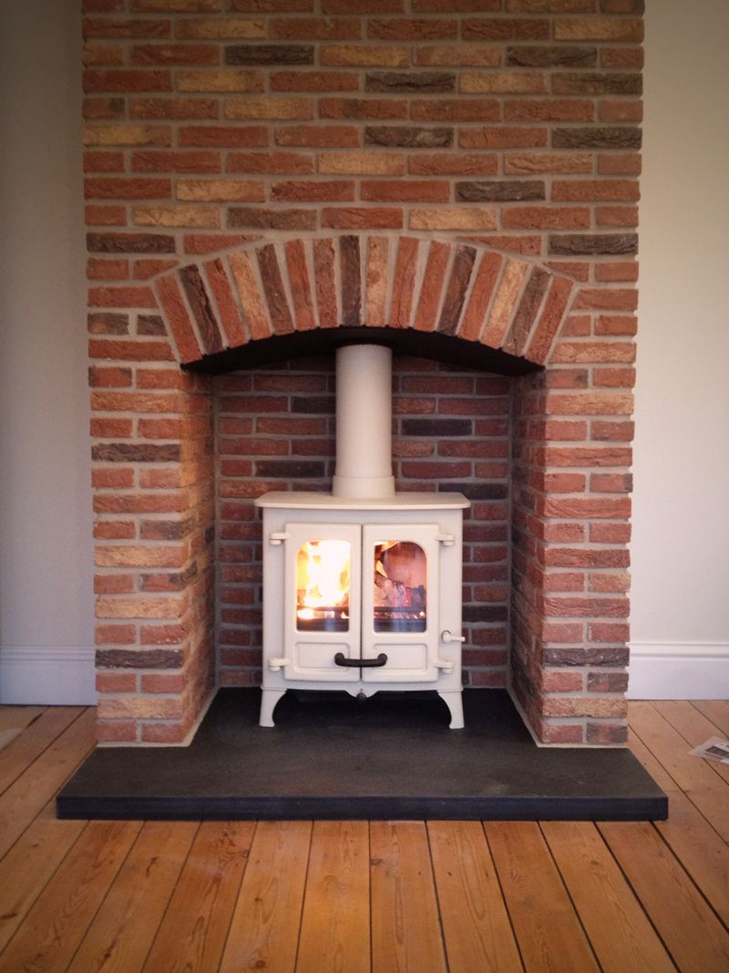 Brick fireplace surround woodburner google search for Wood fireplace surround designs