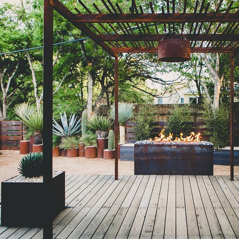 San Antonio TX. Fabricated steel pergola planter boxes fire pit and