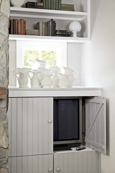 A small tv concealed within a beadboard cabinet photograph by laura moss for this old