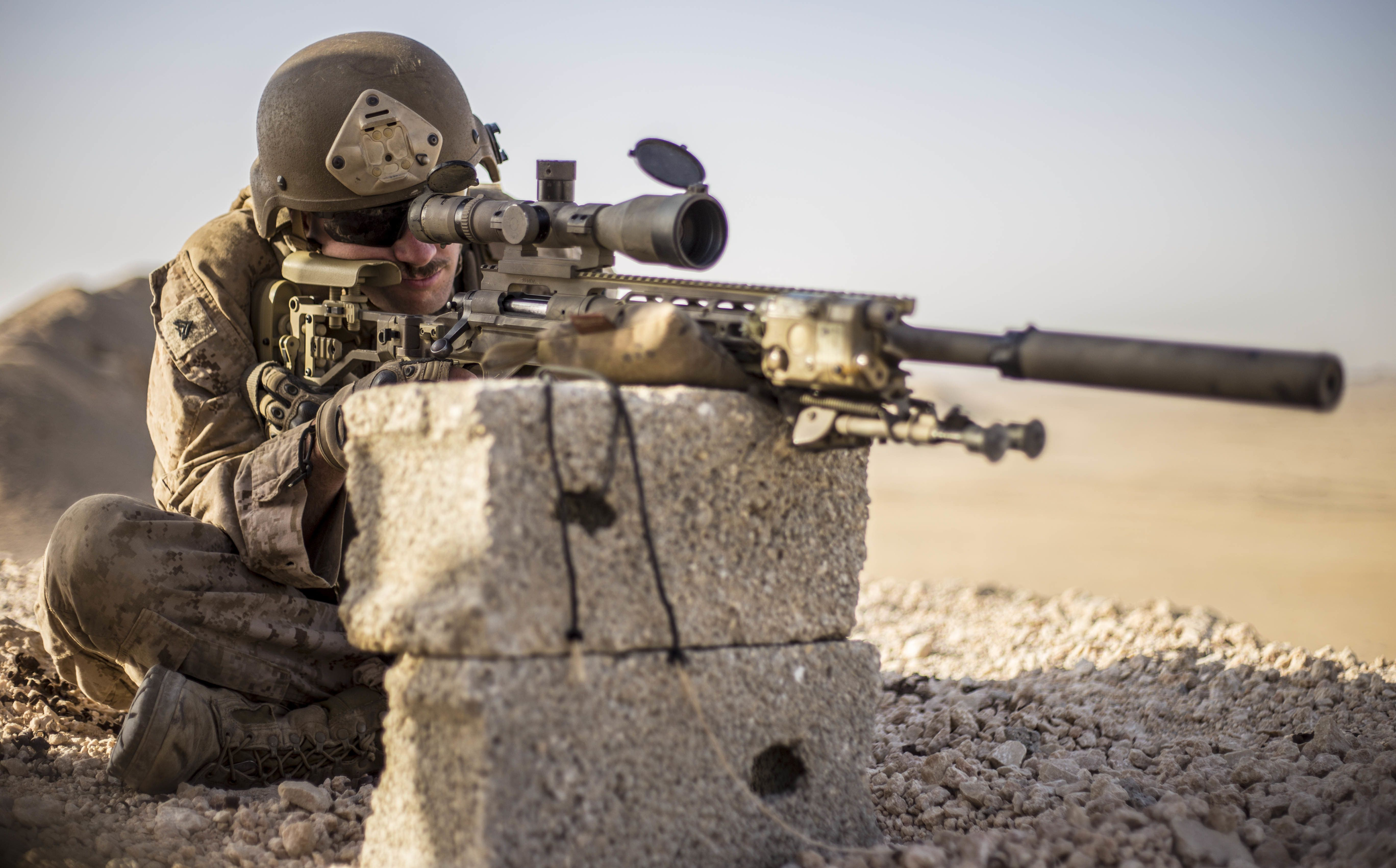 6c1e85ef U.S. Marine Scout Sniper with Weapons Co. 1 Bn. 4th Marines sights in with  his M110 Semi-Automatic Sniper System during an unknown distance range as  part of ...