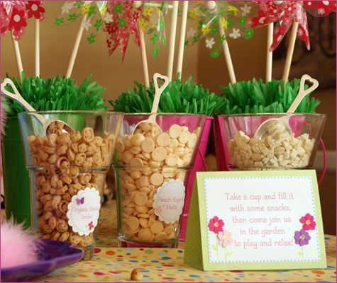 I love this! Since there were lots of babies at the party, Dana set up glass containers with baby-friendly fare like yogurt melts, organic puffs and dried fruit, along with miniature multi-colored snack cups so their parents could fill one up and take it outside to the garden.