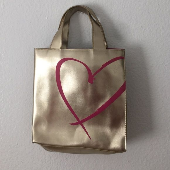 Victoria Secret Gold Tote Small Vs tote. Great Condition.  Great for a small weekend bag or to use as a purse. Victoria's Secret Bags Totes