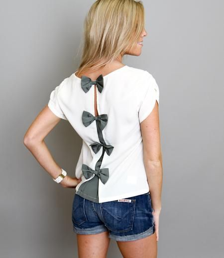 Bow back closure. Easy to do with a plain white t-shirt!