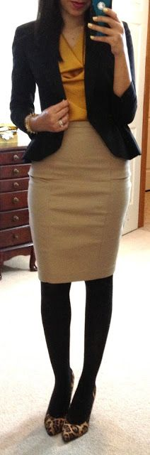 Blouse and Skirt with or without jacket. Heels or flats.