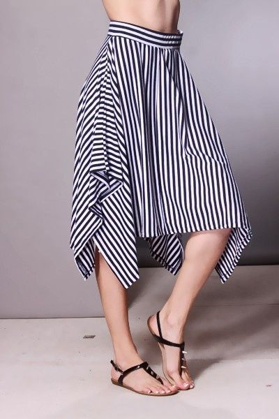 A comfy knit skirt with allover vertical stripes, a banded waist, and draped sides. 76% Polyester/19% Rayon/5% Spandex