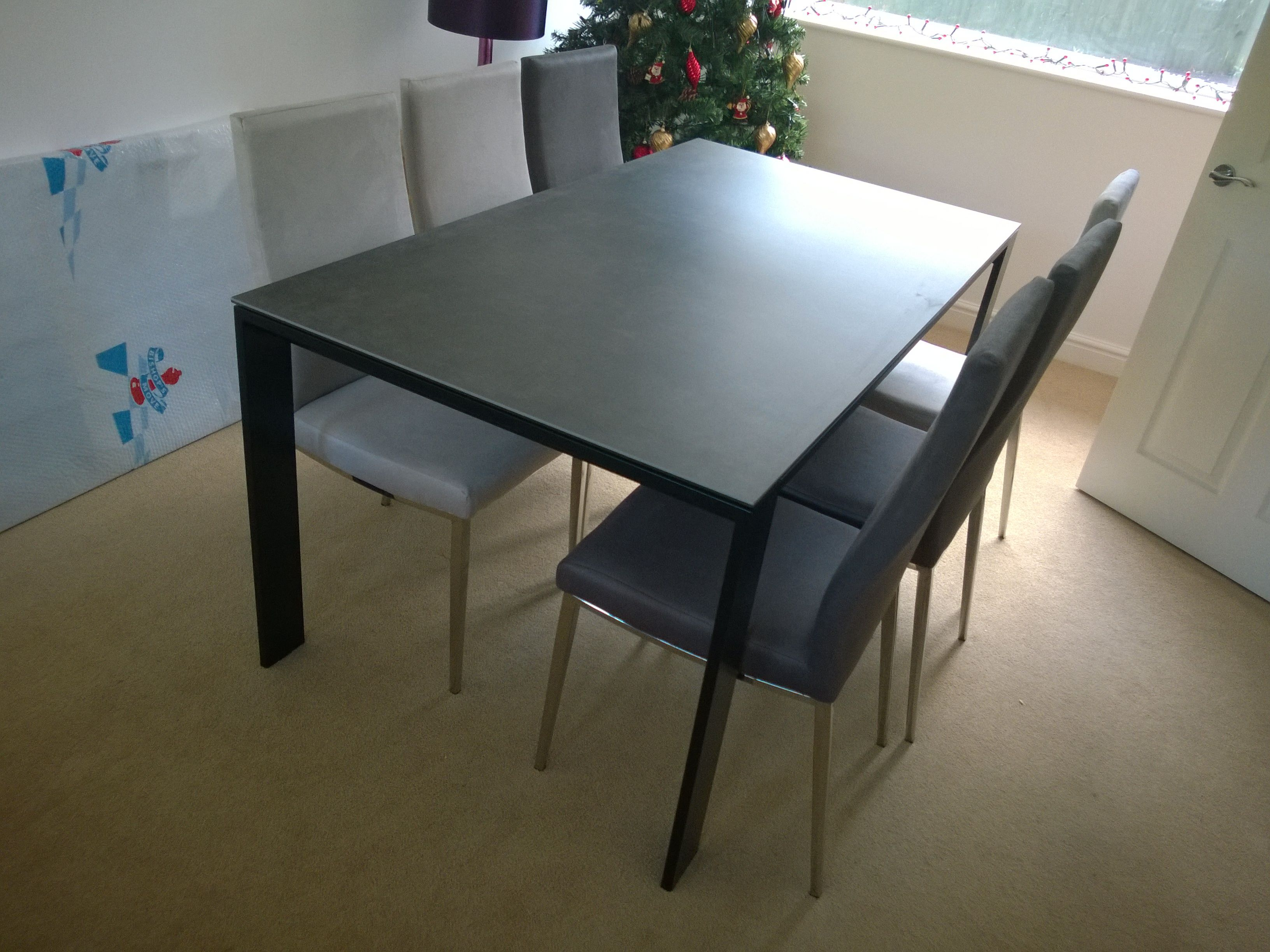 Cosmopolitan Extendable Dining Table In Ceramic Top With Matte Black Frame.  Table Size Is 165cm