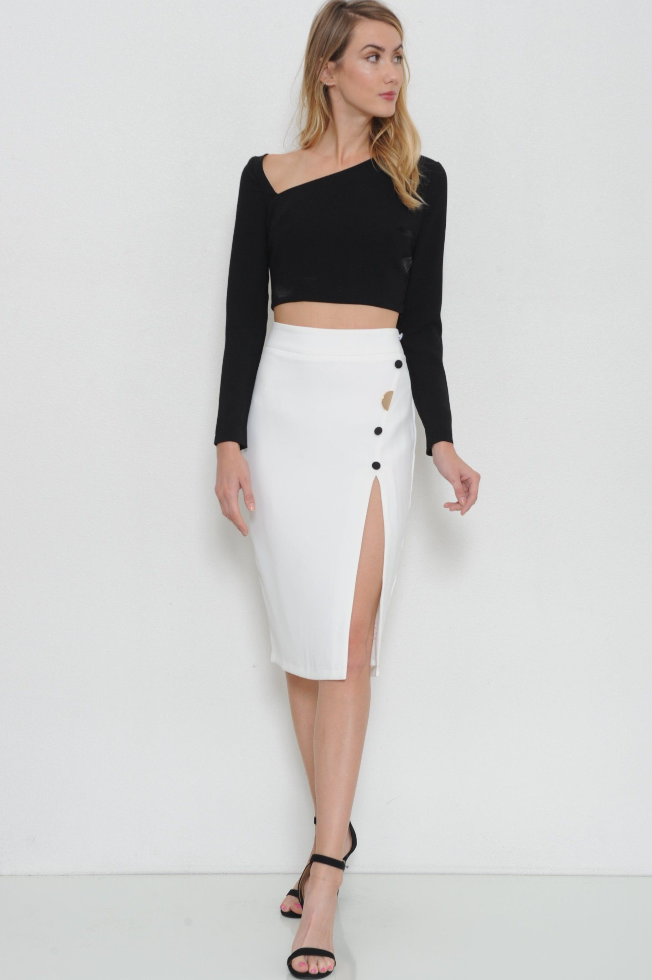 535f0b75b3f292 Show off all your best sides in this skirt set featuring v neck off the side  top. Tapered fit. Long sleeve. Skirt with 3/4 angled slit with black button  and ...