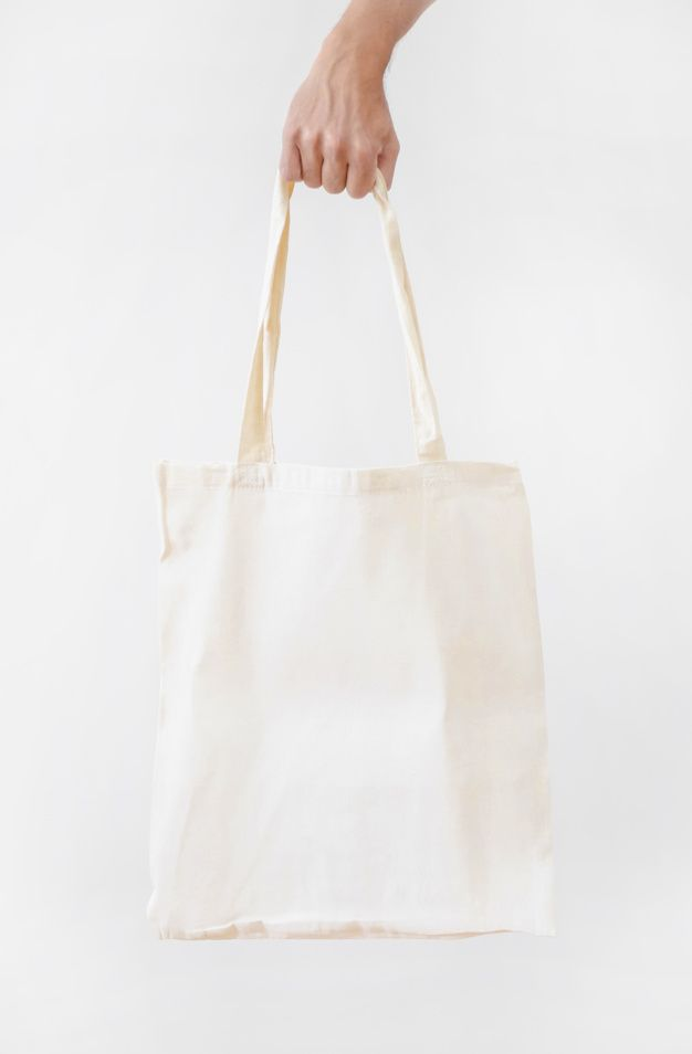 Download Download Hand Holding Blank White Fabric Canvas Bag Isolated Over White Background For Free White Fabrics Blank Tote Bag Canvas Bag