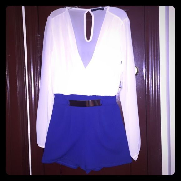 Blue & white romper Small snag on top but is hidden by the folds. Belt attached Pants Jumpsuits & Rompers